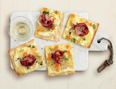 Flammkuchen (tarte flambée) with bacon and raclette