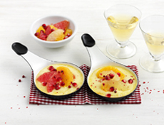Raclette with pomegranate and citrus fruits