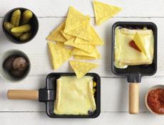 Tortilla chips trays with raclette cheese